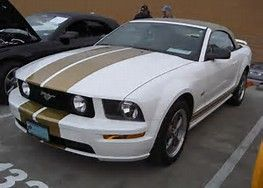 Image result for White 2007 Mustang With Convertible Tan Top and Blue Stripes