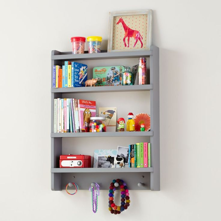Take it from us, kids. Hanging up your stuff is the right thing to do. With space to store tons of books, pictures and keepsakes, plus hang up hats and coats, this wall rack ought to have quite the shelf life around your house.