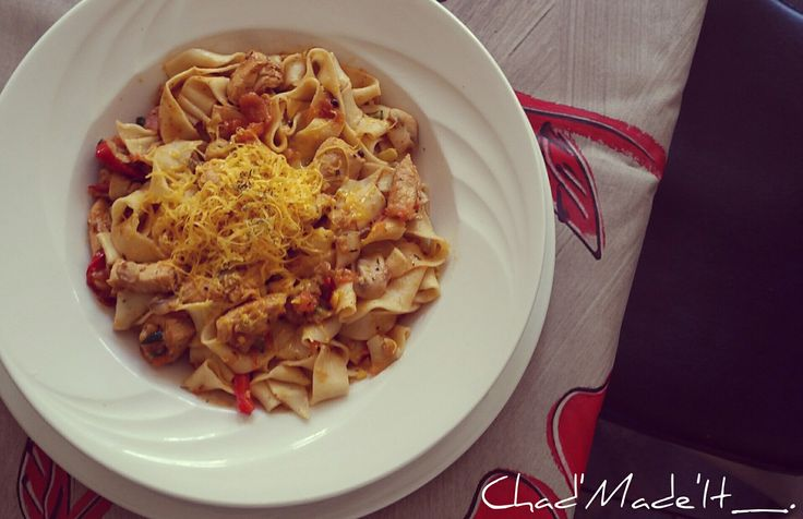 Thai styled chicken Pasta. Topped with cheddar