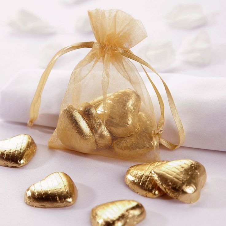 ideas for beach wedding party favors%0A White and Gold Wedding Favors  Maybe a white bag with gold wrapped  chocolates inside