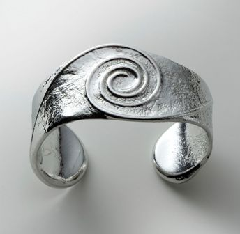 Polished Pewter Cuff €35 - Reaction Jewellery, very Celtic in design.