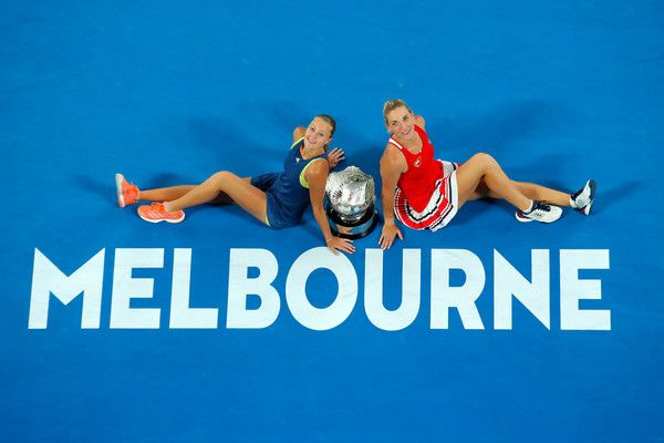 Kristina Mladenovic (L) of France and Timea Babos of Hungary pose for a photo with the championship trophy after winning the women's doubles final against Ekaterina Makarova of Russia and Elena Vesnina of Russia on day 12 of the 2018 Australian Open at Melbourne Park on January 26, 2018 in Melbourne, Australia.