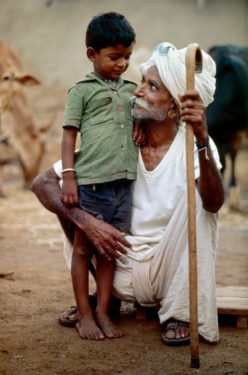 kafiristan:  Looking Across Generations in Hyderabad by United Nations Photo. A grandfather in the Banjara tribal community showers his affection on a young boy near Hyderabad, India.Photo ID 387975. 01/01/1981. Hyderabad, India. UN Photo/John Isaac.