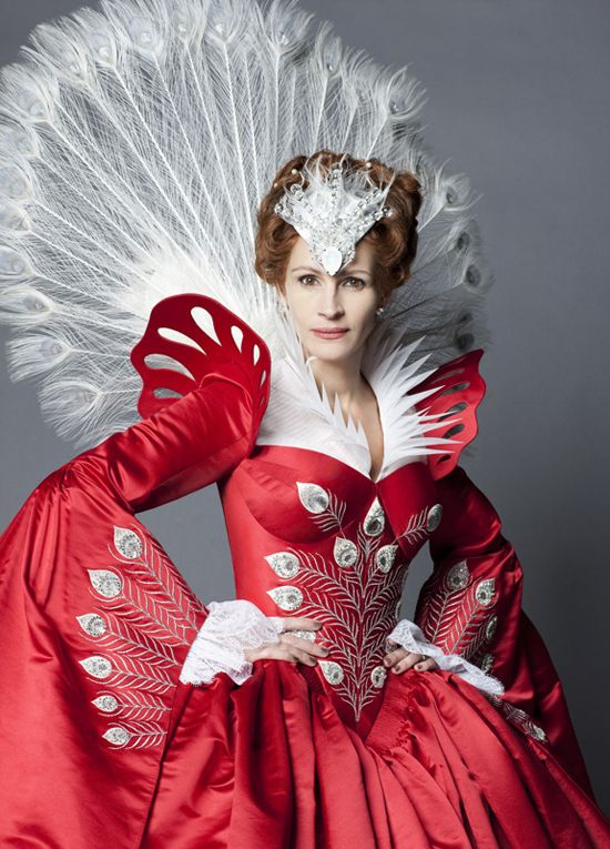 Mirror Mirror - Julia Roberts as the Evil Queen, wearing a red satin dress with peacock-inspired embroideries.    The costumes were designed by Eiko Ishioka, who had also designed the costumes for other movies by Tarsem Singh - The Cell, The Fall and Immortals.