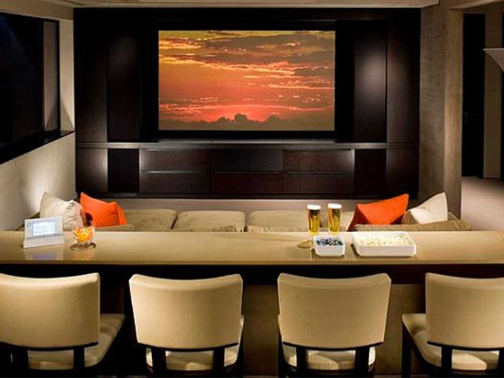 Simple Home Theater Design With Wooden Screen Cabinets And Simple Brown  Sofa On Front Of Long