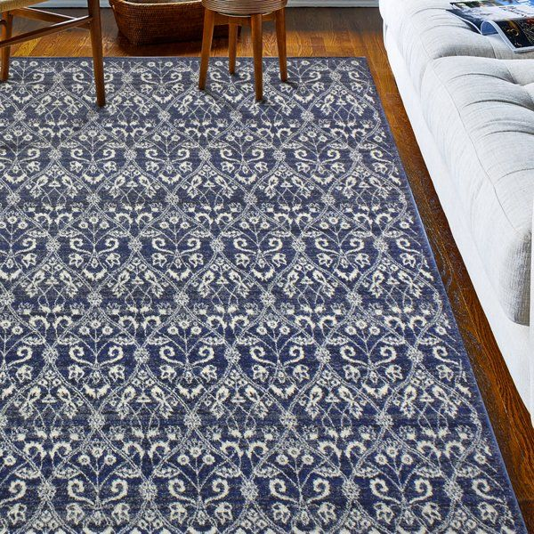Whether you prefer global and eclectic ensembles or you've curated a cohesive chic aesthetic in your home, this area rug is a versatile addition to your abode. Machine-woven from 100 percent polypropylene, this piece is an ideal anchor for a busy entryway or another high-traffic room. Its ikat pattern adds allure to any arrangement, while its dark blue tone brings understated appeal to your space. This design doesn't require a rug pad, so you can instantly roll it out and round out yo...
