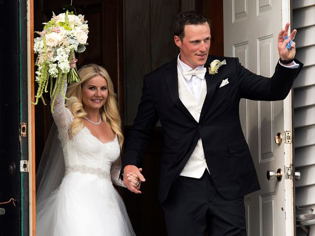 Toronto Maple Leafs captain Dion Phaneuf and actress Elisha Cuthbert head from their wedding at St. James Catholic Church in Summerfield, P.E.I. on Saturday, July 6, 2013.