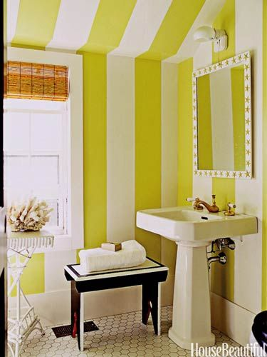 OOOH! More fancy, fun stripes found on @House Beautiful... Designer Leslie Klotz used paint to create big, bold #stripes in this Hamptons' cottage #bathroom: Apple Green and Decorator's White, both by #Benjamin Moore.