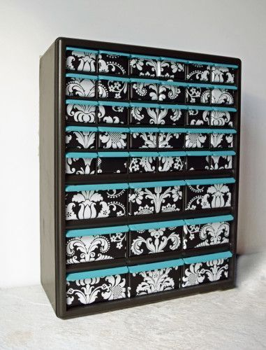 Craft Drawer Organization, This is one of those garage nuts and bolts organizers that she added wall vinyl to. Now it's girly to hold all of your little craft and office supplies. Love the card catalog style on a budget.