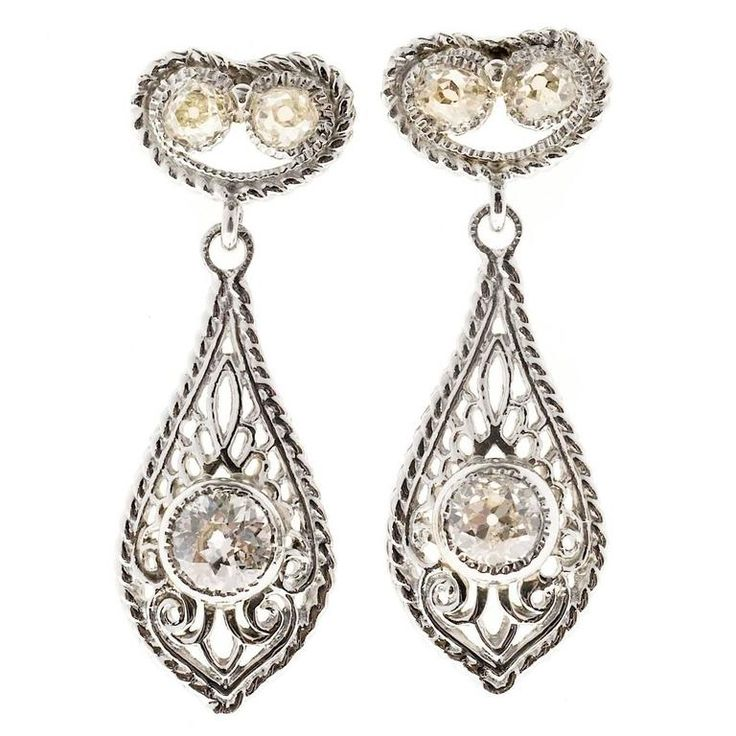 Antique Diamond Open Work Platinum Earrings | From a unique collection of vintage dangle earrings at https://www.1stdibs.com/jewelry/earrings/dangle-earrings/