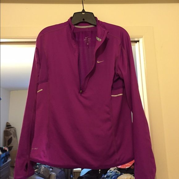 Nike women's zip up long sleeve Nike women's zip up, long sleeve with mesh back panel. Zippered back pocket for keys/other. Another extra pocket. Thumb homes. Magenta in color. Small darker stain on back see pictures. Still great condition (minus stain ) Nike Tops
