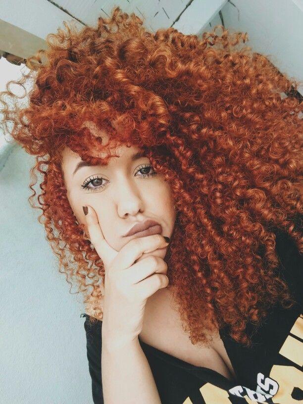 Curly natural, redhead.