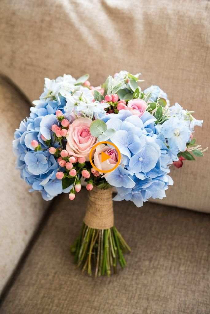 Soft Pink Roses And Baby Blue Hydrangeas Bloom In This Beautiful Brewing Flower Bouquet Wedding Fresh Wedding Flowers Prom Flowers Bouquet