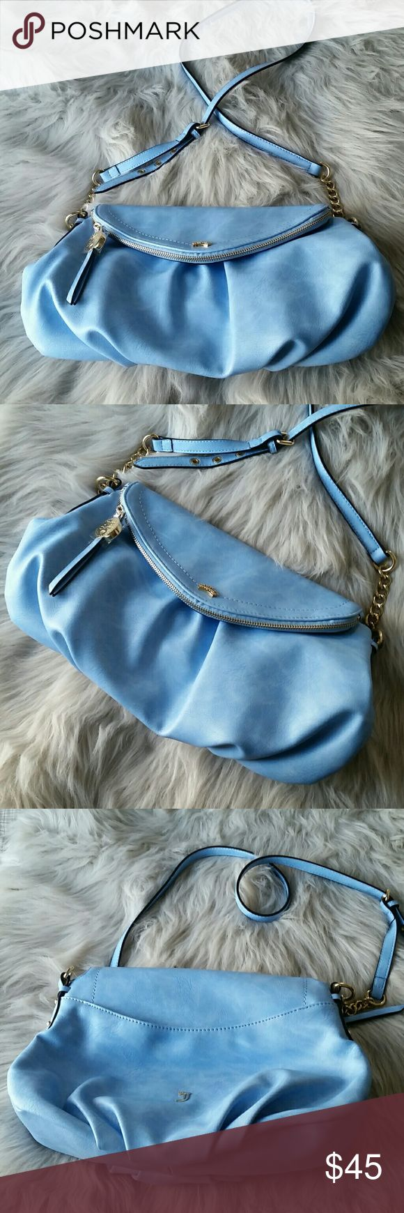 Juicy Couture large crossbody bag light blue Juicy Couture large crossbody bag. Brand new without tags! Never worn/used.  * crossbody style with adjustable strap * gold hardware * bright pink monogram lining * hidden zipper compartment  I love offers! Please feel free to negotiate price through the offer button. Juicy Couture Bags Crossbody Bags