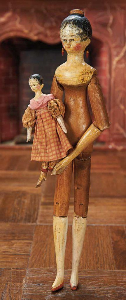 Early Grodnertal Wooden Doll with Tuck Comb With Little Doll