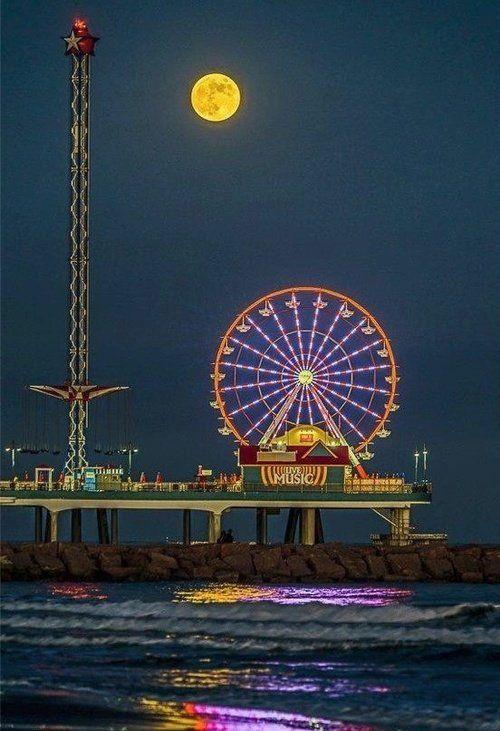 Full moon, Ferris wheel over Galveston, Texas.
