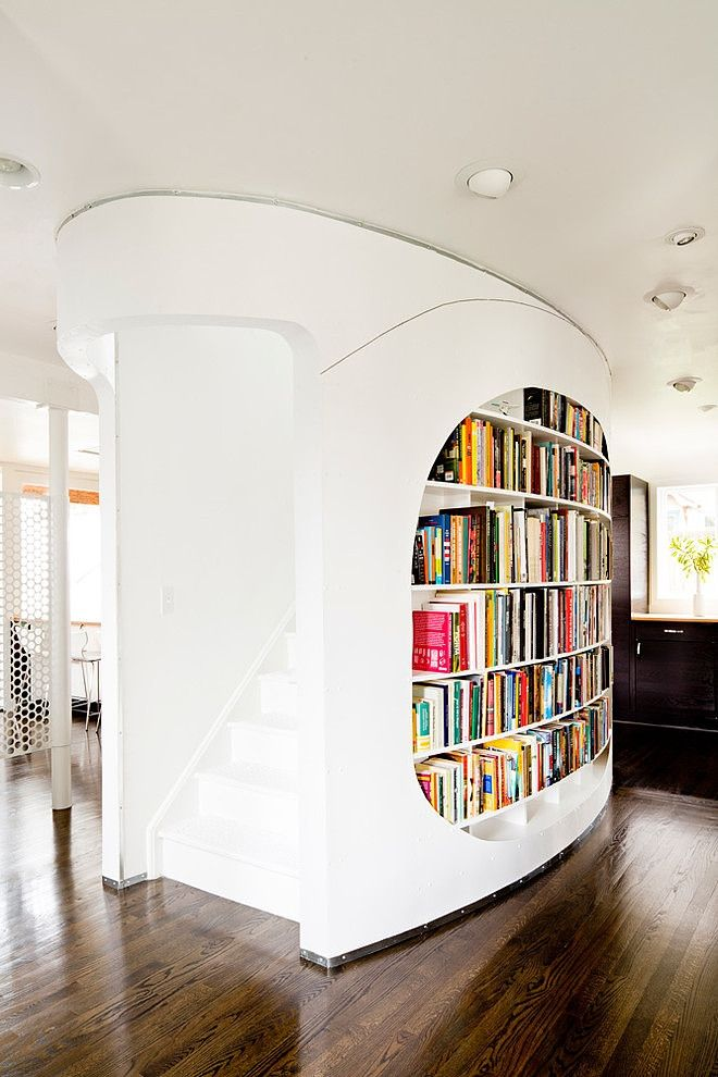 Love the curves on this stairwell/bookcase in the Eyebrow House by Papazian R.A.