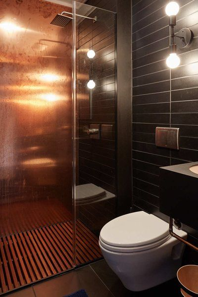 The Bathroom Features 2 Copper Walls Paper Composite Tiles Floor To Ceiling And An Ipe Shower Mat