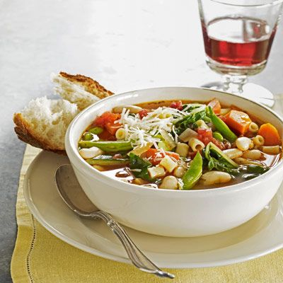 Hearty vegetables, cannellini beans, and tubetti pasta are combined in this mixed vegetable minestrone soup.