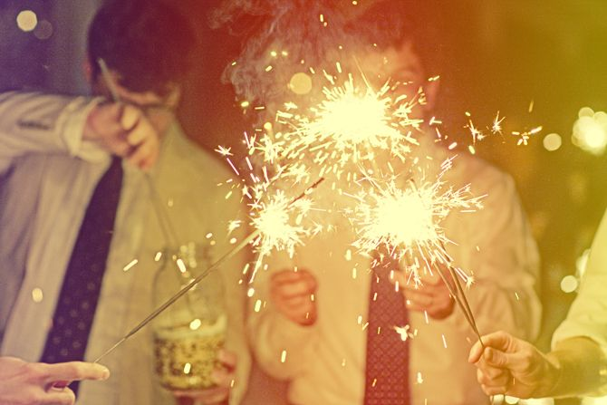 sparklers!   My favorite holiday the 4th of July. Fireworks, friends, family, great food and fireworks.