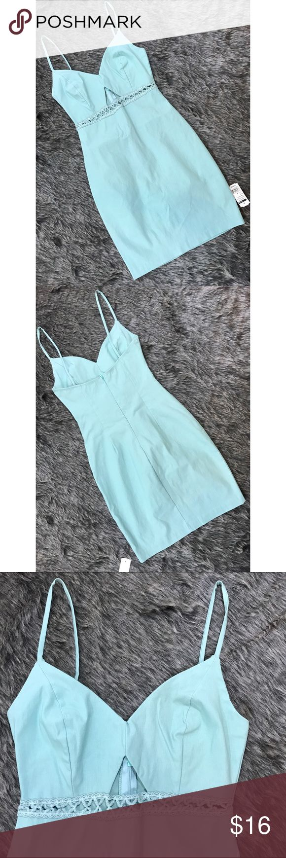 Mint colored bodycon vegas cocktail dress Extra stretchy, curve hugging dress with front cut-out detail. 74% rayon/22% nylon/4% spandex.  pit to bottom hem=24 inches Image Dresses Mini