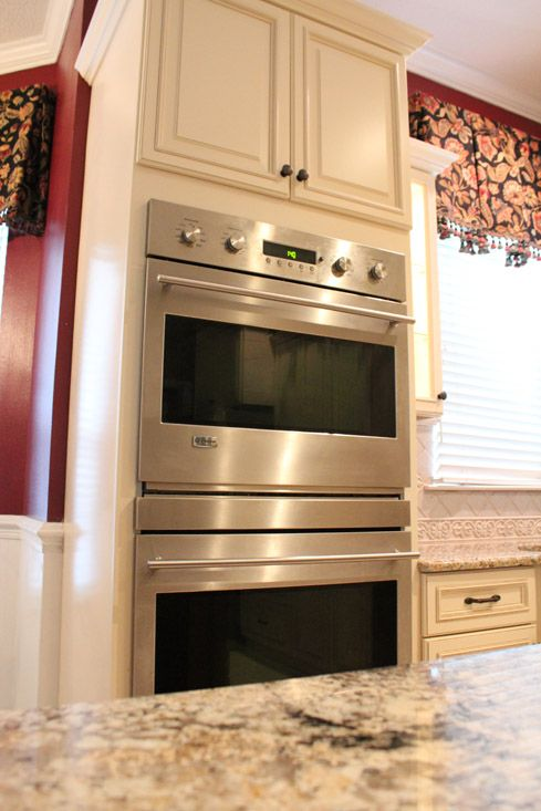 Fabuwood cabinetry wellington door style ivory glaze for Why are cabinets so expensive