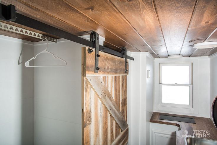 The Roving Rolling Door Detail by 84 Tiny Houses - 84 Lumber