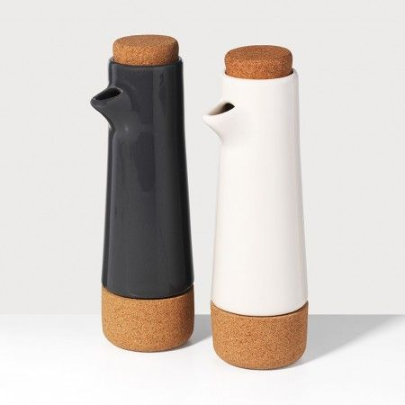 Alma Oil and Vinegar Cruets | Unison | A cork stopper works wonderfully for wine bottles. Now, it's oil and vinegar's chance to get a piece of the action. Keep the two ingredients on standby for salad-dressing duty in cork and earthenware vessels, inspired by Portuguese pottery.