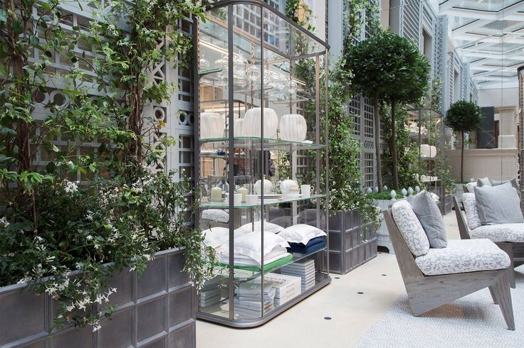 Peter Marino designed the Home space in the new Dior shop to resemble a conservatory, with greenery along the white trellis and a diamond-shaped skylight that runs the entire length of the entrance.