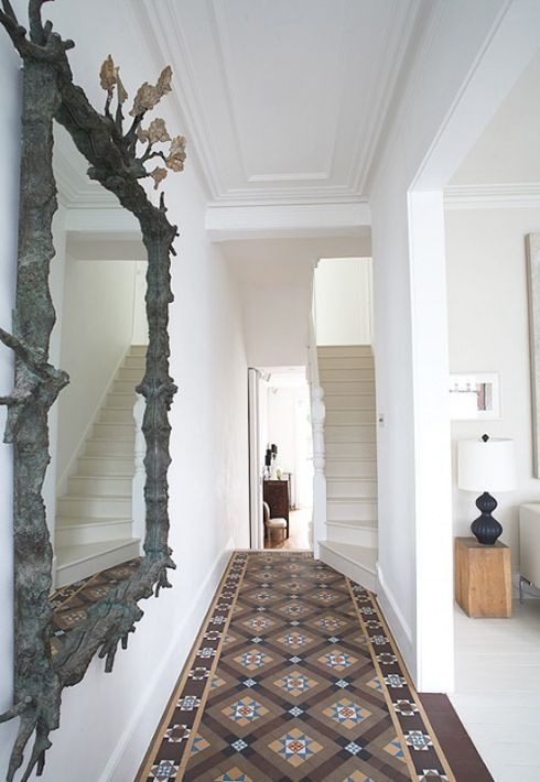I love this entrance...gorgeous mirror and stunning floor are really eye catching against the white.