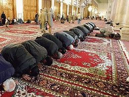 This image depicts Muslim men praying together. Religious rituals vary greatly across cultures and religions, but they most serve the purpose of uniting the group. Feelings are increased by being reflected in the feelings of the group, which increases the overall power of the religion.