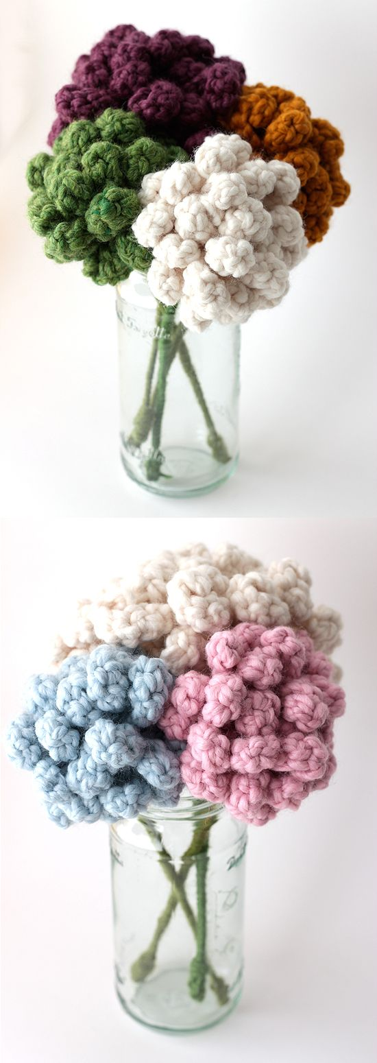a different kind of crochet flower.  there's no pattern - but they look like they'd be pretty easy.  very cute idea!
