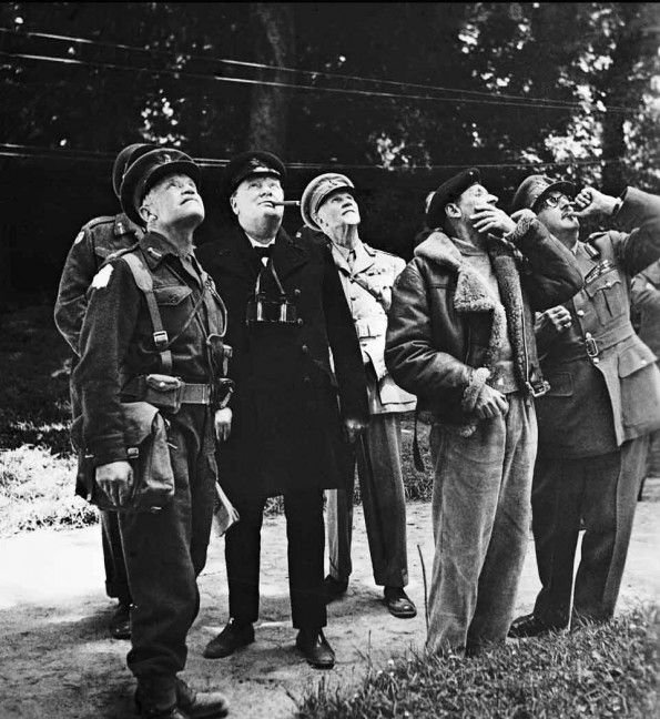 WW II. Winston Churchill watching air activity with other senior officers above General Sir Bernard Montgomery's headquarters, 12 June 1944. Left to right: Lieutenant-General Sir Richard O'Connor, commanding VIII Corps; Churchill; Field Marshal Jan Smuts; Montgomery; Field Marshal Sir Alan Brooke, Chief of the Imperial General Staff.