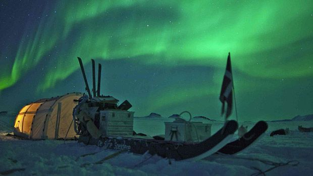 The aurora borealis over a tent of the Sirius Patrol in northern Greenland, temperature -37C.