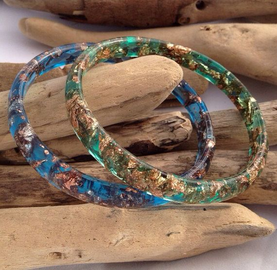 Handmade faceted eco-resin bangle in spearmint green with copper leaf.