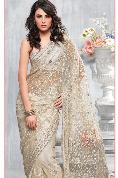 This graceful Saree has rich resham embroidered floral patterns adorned with sparkling sequins, patch border's enhanced with fancy thread work and intricate sequin embroidery, worn with sleek diamond earrings