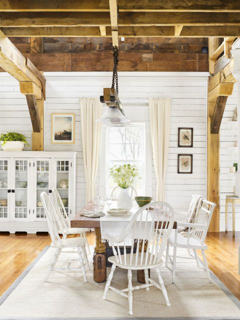 Exposed Wooden Beam Ceiling:  Open ceilings like this add character and recall similarly structured barns or industrial buildings.