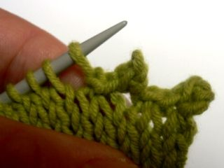 Picot bind off.  Now that I've figured out how to do this, I really like it.  Good, loose bind-off.