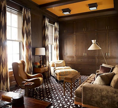 chevron draperies, contemporary leather chair, and those tangerine ceiling panels.  Steven Gambrel.