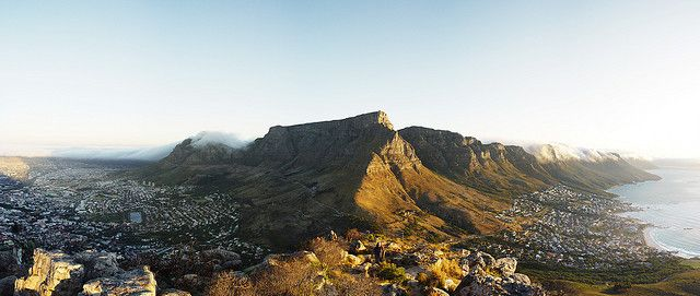 Table Mountain (South Africa). 'Whether you take the easy way up and down on the revolving cableway or put in the leg work and climb, attaining the summit of Table Mountain is a Capetonian rite of passage. Weather permitting, your rewards are a panoramic view across the peninsula and a chance to experience something of the park's incredible biodiversity.' http://www.lonelyplanet.com/south-africa/cape-town/table-mountain-national-park