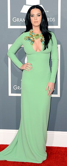 Katy Perry wears a Gucci dress to the 2013 Grammys, and bares a lot of boob. Want this look? Make sure you have very firm breast tissue, and wear very seamless nipple covers. -Linda the Bra Lady