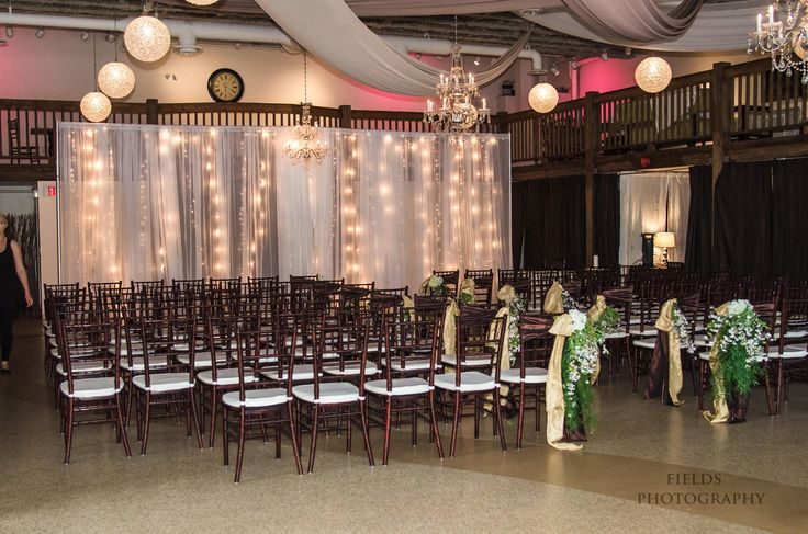Room ceremony with dual twinkle light backdrop