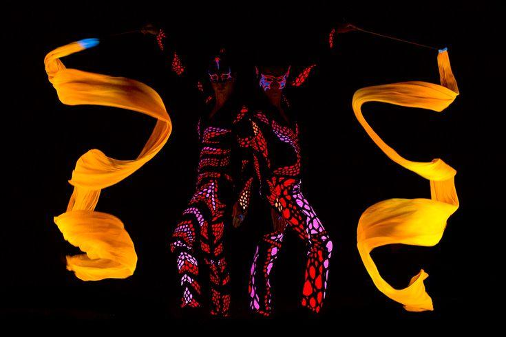 UV dancers Anta Agni - yellow ribbons in black light show   http://antaagni.com/uv-light-show/