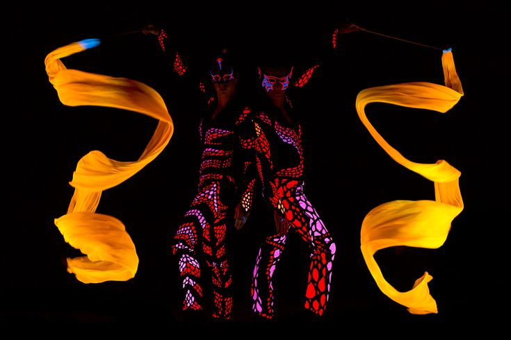 UV dancers Anta Agni - yellow ribbons in black light show   http://antaagni.com/uv-light-show/