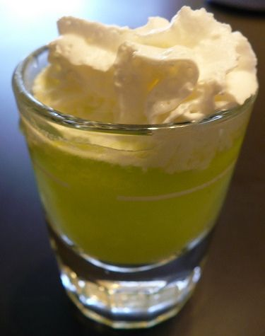 Scooby Snack Shot:  1/2 oz Malibu® coconut rum  1/2 oz creme de bananes  1/2 oz Midori® melon liqueur  1/2 oz pineapple juice  1 1/2 oz whipped cream    Pour rum, creme de banane, melon liqueur and pineapple juice into a stainless steel shaker over ice. Add whipped cream, and shake; until well mixed and sufficiently chilled. Strain into an old-fashioned glass and shoot.