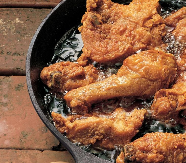 Fried Chicken cooked in a cast iron skillet.
