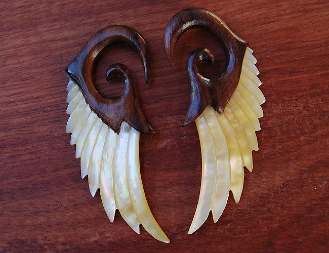 "Avaia Artistic Jewelry  - Glory areng wood and mother of pearl, shell, hangiing ear gauges - 6g - 1/2"" spiral plugs or spacers, $32.99 (http://www.avaiaartisticjewelry.com/glory-areng-wood-and-mother-of-pearl-shell-hangiing-ear-gauges-6g-1-2-spiral-plugs-or-spacers/)"