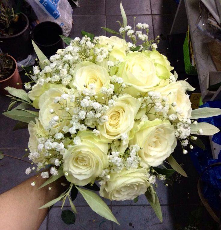 Wedding decoration - flower arrangement -  white roses and olive tree branches - bridal bouquet