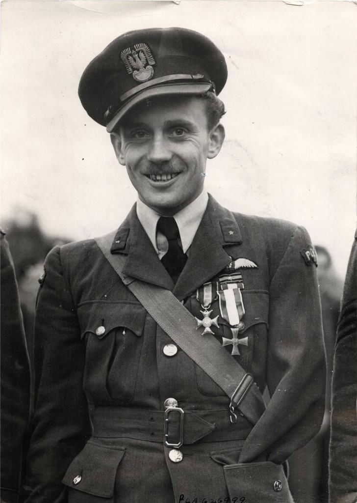 1941- Flying Officer Zdzislaw Radomski of the 306th Polish Fighter Squadron after being decorated by General Sikorski with the highest Polish military honour, the Virtuti Militari, as well as with the Cross of Valour. During Operation 'Circus 85' on 27 August 1941 pilots of the 306th Squadron were attacked by four Bf 109 Messerschmitts over Dunkirk. F/O Radomski was the only Polish pilot wounded; although his arm was shattered he landed his Spitfire safely at his home base, RAF Northolt.