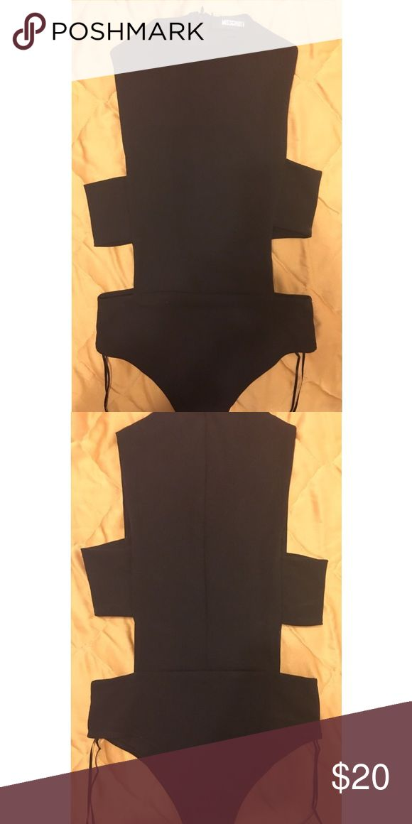 Black cut out bodysuit All black with buttons to work with on the very bottom and a zipper on the back. Really good quality. Form fitting. Never worn. This picture was taken straight out of the delivery package. Missguided Tops Blouses
